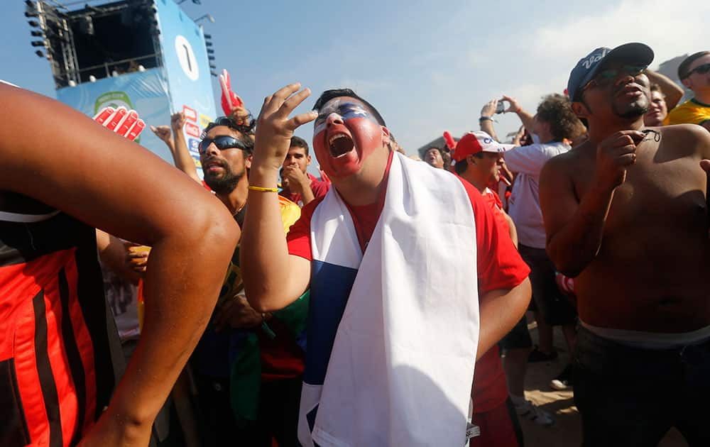 A Chile soccer fan complains as he watches a live telecast of his team's World Cup round of 16 match with Brazil at the FIFA Fan Fest area on Copacabana beach in Rio de Janeiro, Brazil.