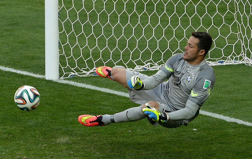 Brazil's goalkeeper Julio Cesar make a save in the shoot-out of the World Cup round of 16 soccer match between Brazil and Chile at the Mineirao Stadium in Belo Horizonte, Brazil.