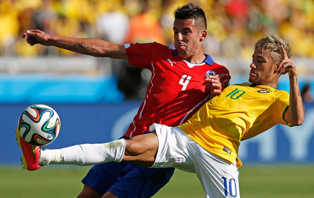 Brazil's Neymar, right, fights for the ball with Chile's Mauricio Isla during their World Cup round of 16 soccer match at Mineirao Stadium in Belo Horizonte, Brazil.