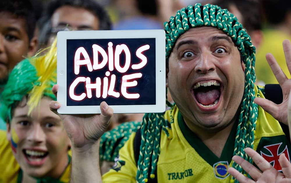 A Brazilian supporter holds up a message for their beaten opponents after the World Cup round of 16 soccer match between Colombia and Uruguay at the Maracana Stadium in Rio de Janeiro, Brazil.