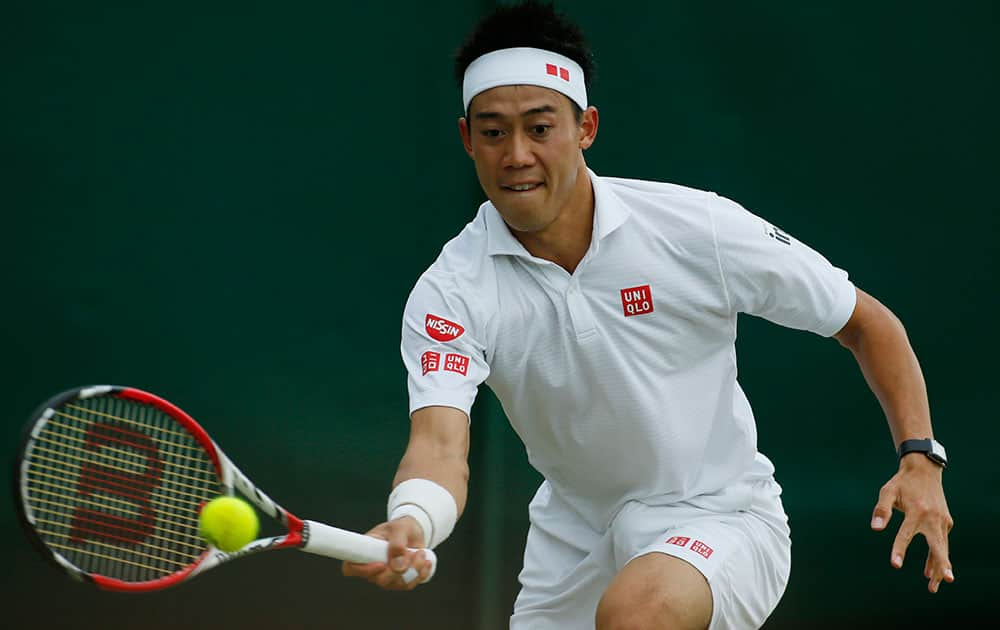 Kei Nishikori of Japan plays a return to Simone Bolelli of Italy during their men's singles match at the All England Lawn Tennis Championships in Wimbledon, London.