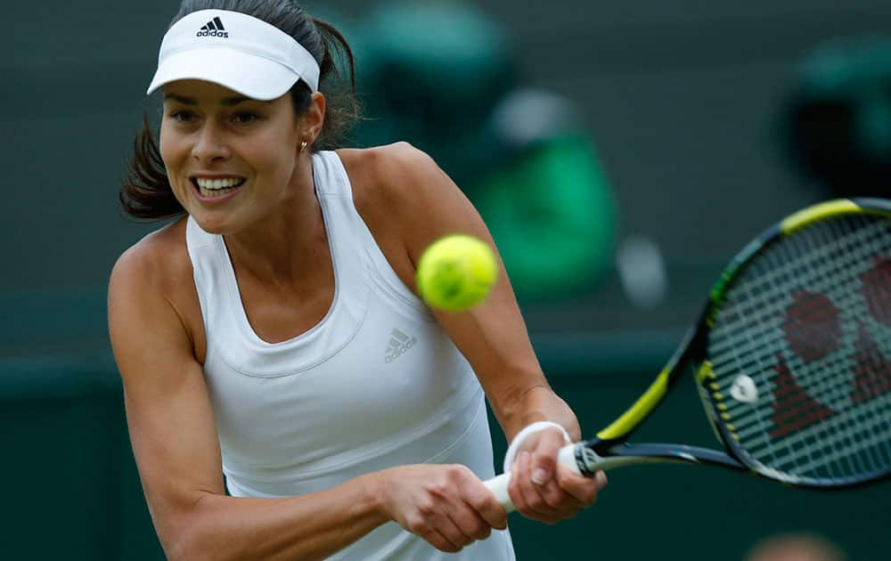 Ana Ivanovic of Serbia plays a return to Sabine Lisicki of Germany during their women's singles match at the All England Lawn Tennis Championships in Wimbledon, London.