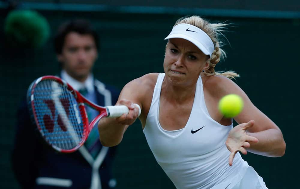 Sabine Lisicki of Germany returns to Ana Ivanovic of Serbia during their women's singles match at the All England Lawn Tennis Championships in Wimbledon, London.