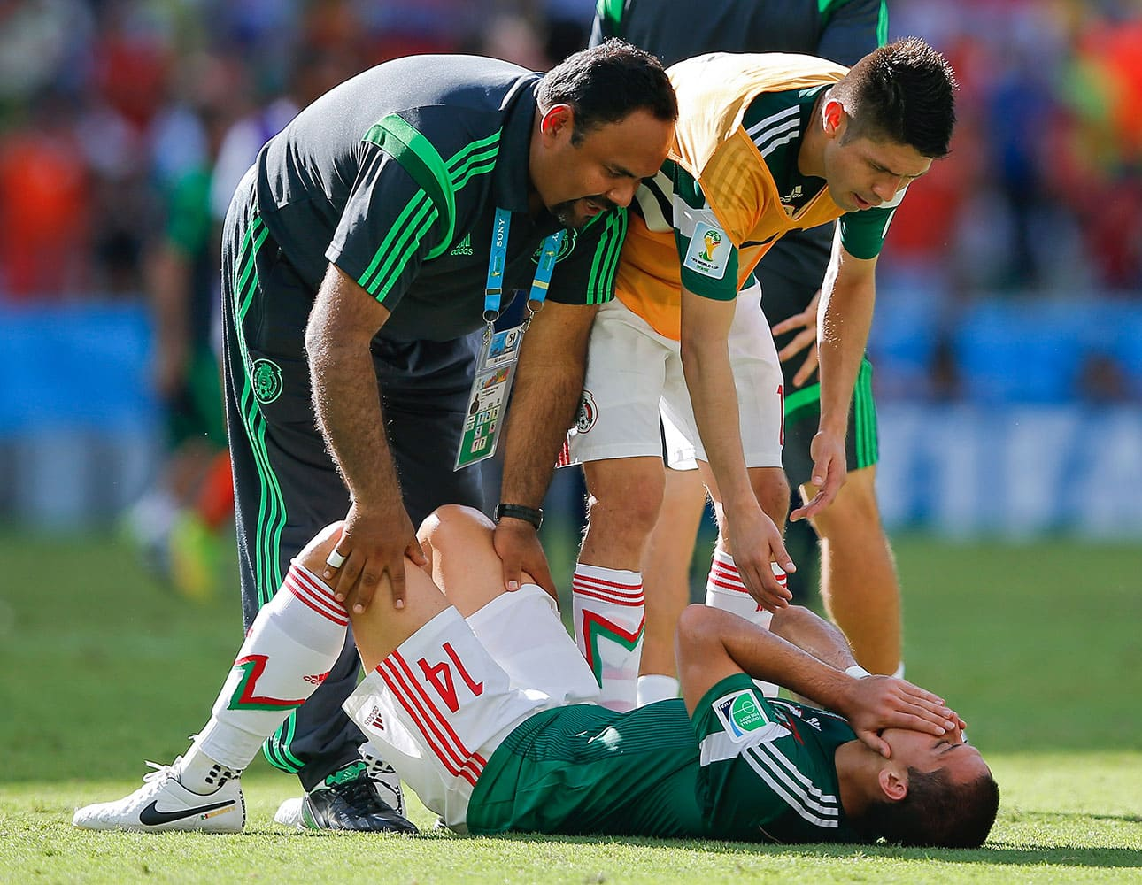 Teammates try to console Mexico's Javier Hernandez after the Netherlands defeated Mexico 2-1 to advance to the quarterfinals during the World Cup round of 16 soccer match between the Netherlands and Mexico at the Arena Castelao in Fortaleza, Brazil.