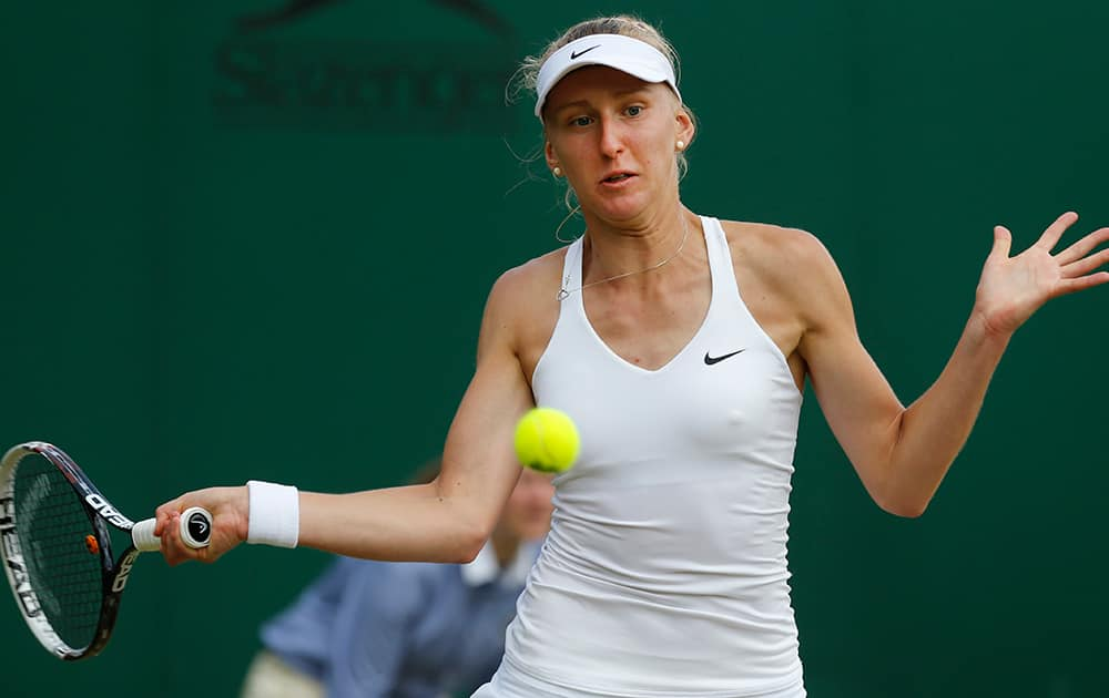 Tereza Smitkova of the Czech Republic plays a return to Lucie Safarova of the Czech Republic during their women's singles match at the All England Lawn Tennis Championships in Wimbledon.