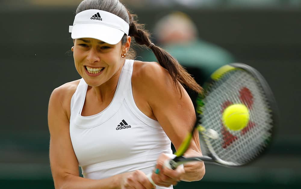 Ana Ivanovic of Serbia plays a return to Sabine Lisicki of Germany during their women's singles match at the All England Lawn Tennis Championships in Wimbledon.