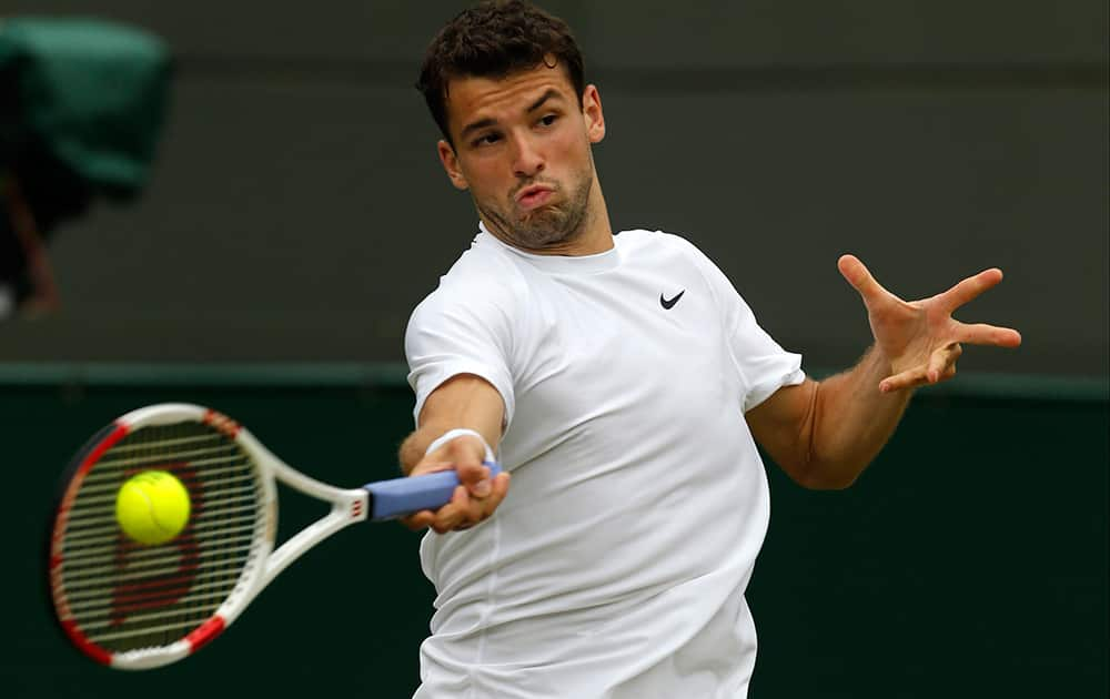 Grigor Dimitrov of Bulgaria plays a return to Leonardo Mayer of Argentina during their men's singles match at the All England Lawn Tennis Championships in Wimbledon.