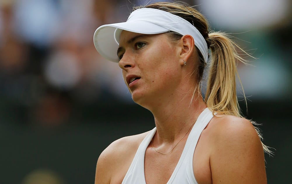 Maria Sharapova of Russia looks dejected after losing a point to Angelique Kerber of Germany during their women's singles match at the All England Lawn Tennis Championships in Wimbledon, London.