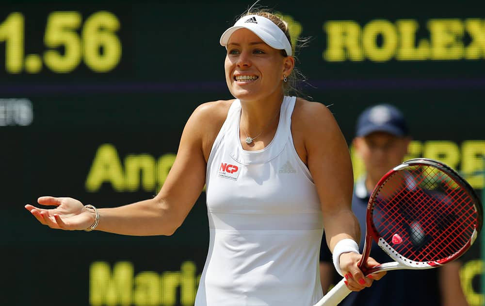 Angelique Kerber of Germany gestures during her women's singles match against Maria Sharapova of Russia at the All England Lawn Tennis Championships in Wimbledon, London.