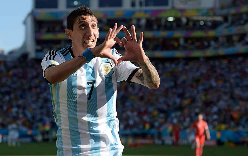 Argentina's Angel di Maria celebrates after scoring his side's only and winning goal in extra time during the World Cup round of 16 soccer match between Argentina and Switzerland at the Itaquerao Stadium in Sao Paulo, Brazil.