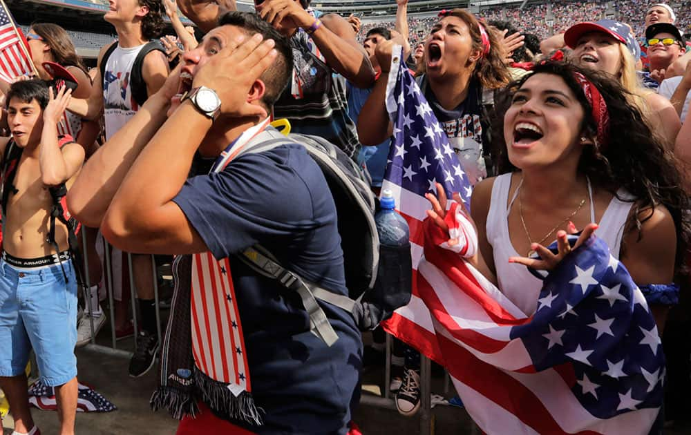 Fans cheer for the U.S. during the Brazil 2014 World Cup viewing party at Soldier Field  in Chicago.