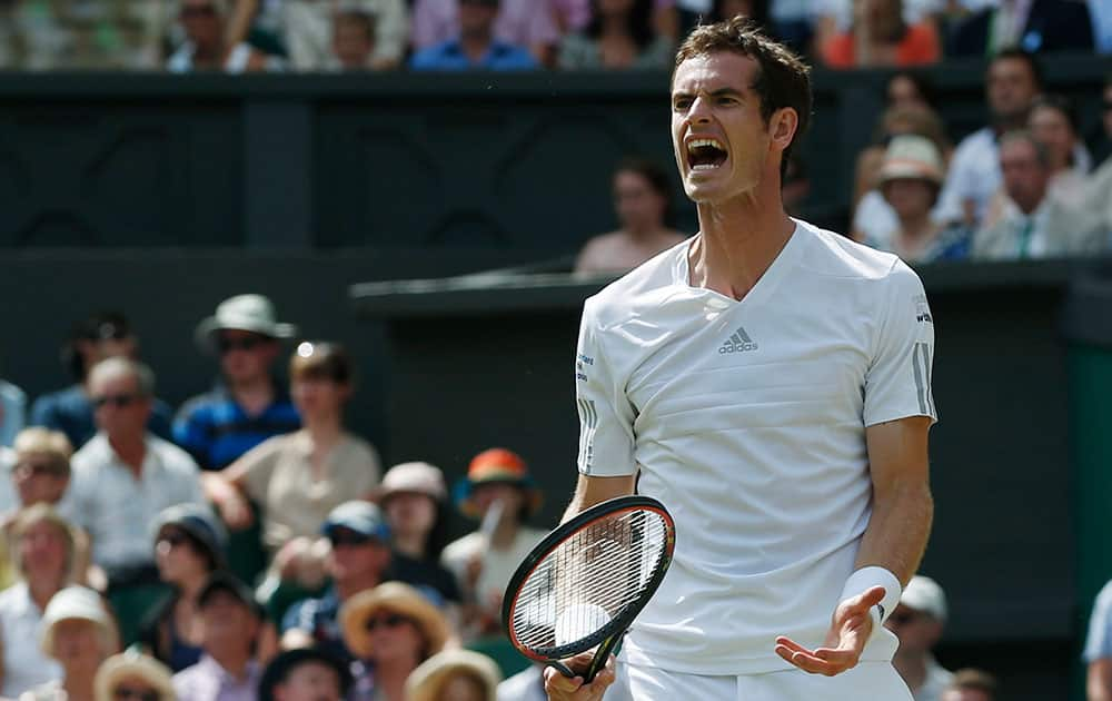 Andy Murray of Britain reacts in frustration during his men's singles quarterfinal match against Grigor Dimitrov of Bulgaria at the All England Lawn Tennis Championships in Wimbledon.