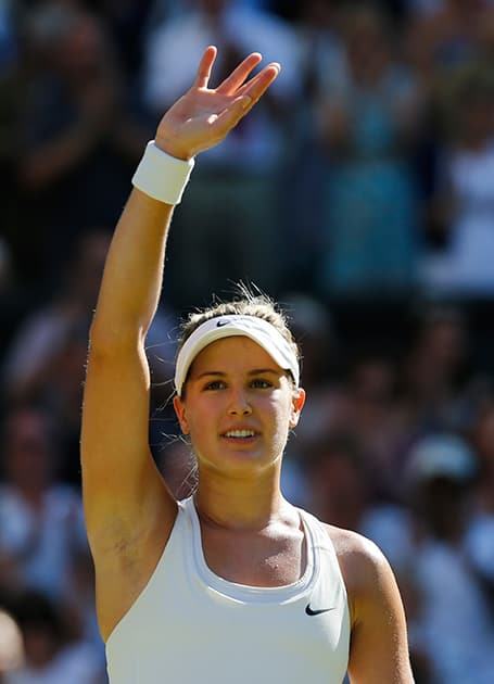 Eugenie Bouchard of Canada waves to the crowd after defeating Simona Halep of Romania in their women's singles semifinal match at the All England Lawn Tennis Championships in Wimbledon, London.