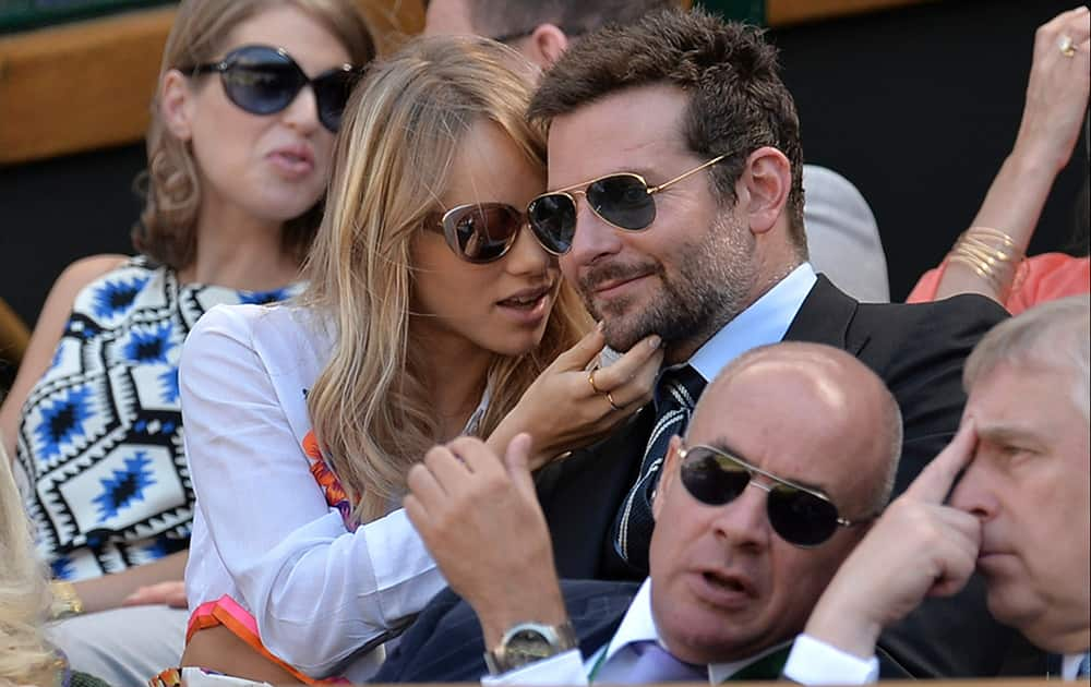 Bradley Cooper and Suki Waterhouse sit in the Royal Box on centre court to watch the men's singles semifinal match between Novak Djokovic of Serbia and Grigor Dimitrov of Bulgaria at the All England Lawn Tennis Championships in Wimbledon, London.