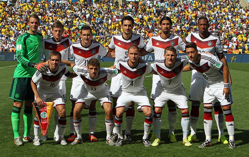 The German team poses for a group photo before the World Cup quarterfinal soccer match between Germany and France at the Maracana Stadium in Rio de Janeiro, Brazil.