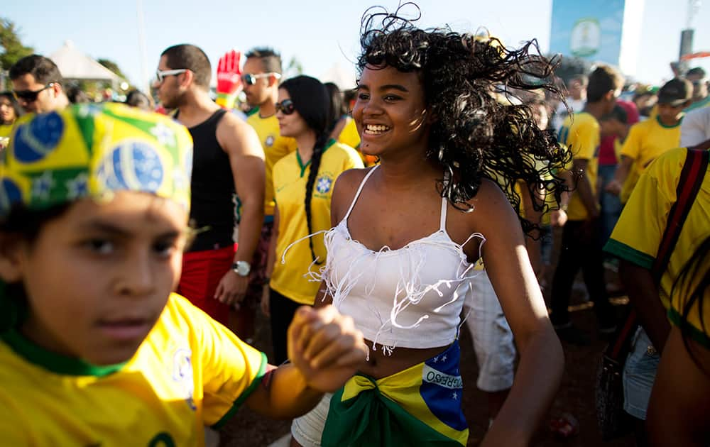 Brazil soccer fans gather inside the FIFA Fan Fest area during the World Cup game between Colombia and Brazil in Taquatinga, Brazil.