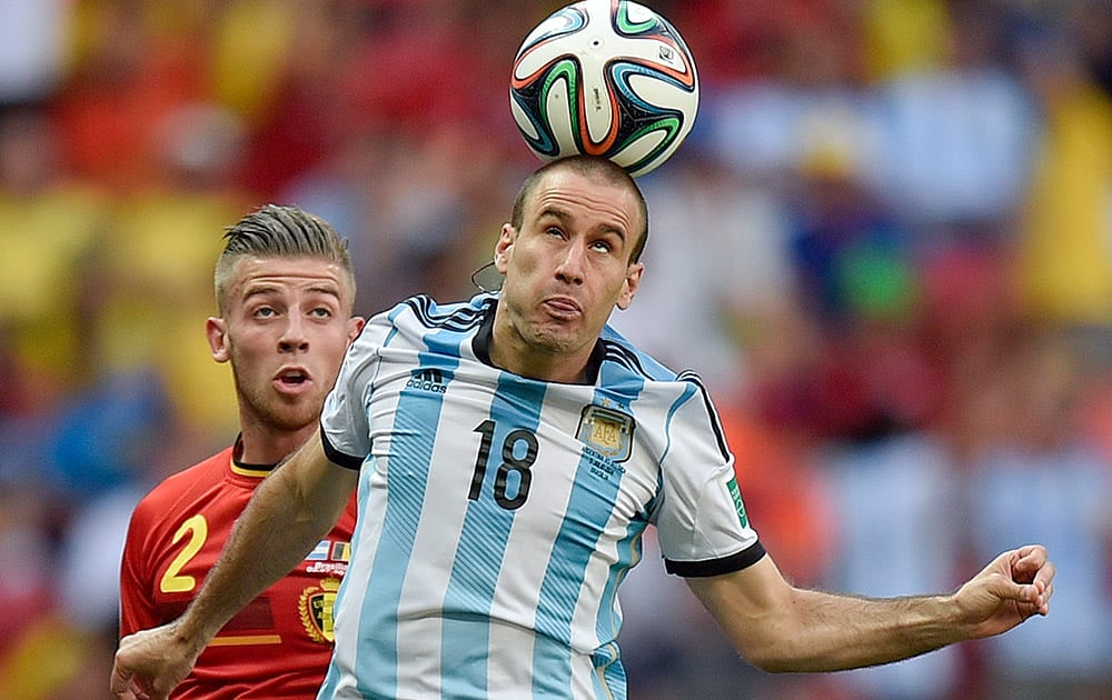 Argentina's Rodrigo Palacio wins a header during the World Cup quarterfinal soccer match between Argentina and Belgium at the Estadio Nacional in Brasilia, Brazil.