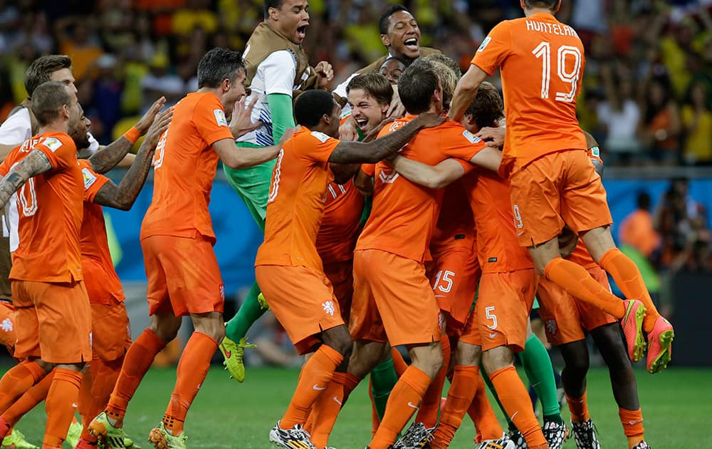 Netherlands' players celebrate after winning on penalty kicks the World Cup quarterfinal soccer match between the Netherlands and Costa Rica at the Arena Fonte Nova in Salvador, Brazil.