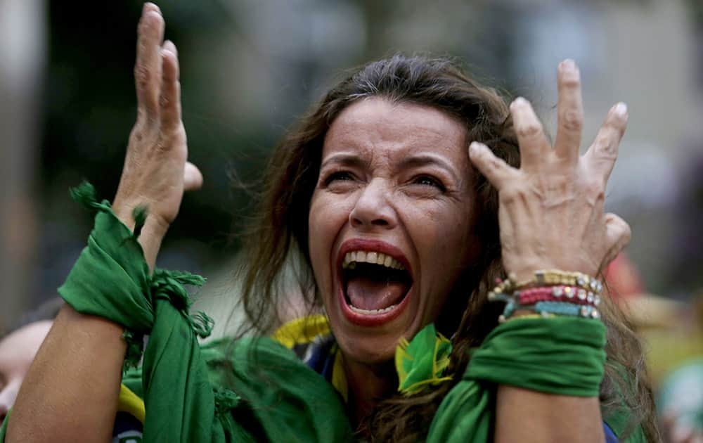 A Brazil soccer fan screams as Germany defeats her team 7-1 in a semifinal World Cup match as she watches the game on a live telecast in Belo Horizonte, Brazil.