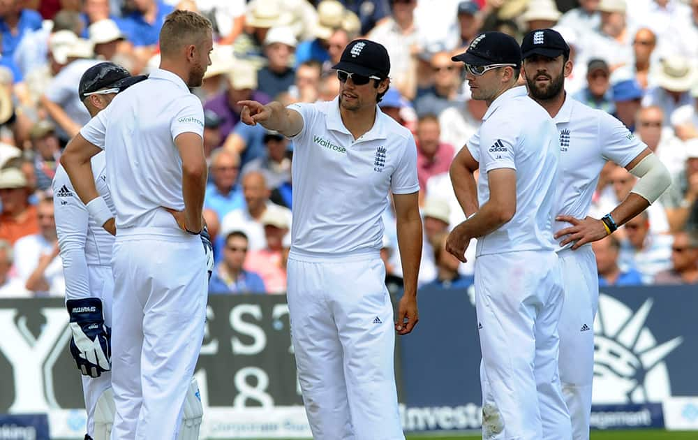 England captain Alastair Cook, center, gestures while talking to players, from second left to right, Stuart Broad, James Anderson and Liam Plunkett during day one of the first Test between England and India at Trent Bridge cricket ground.