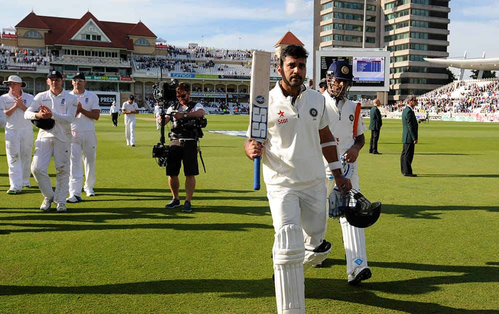 India's Murali Vijay leaves the field after scoring 122 runs not out, at the end of play of day one of the first Test between England and India at Trent Bridge cricket ground, Nottingham, England