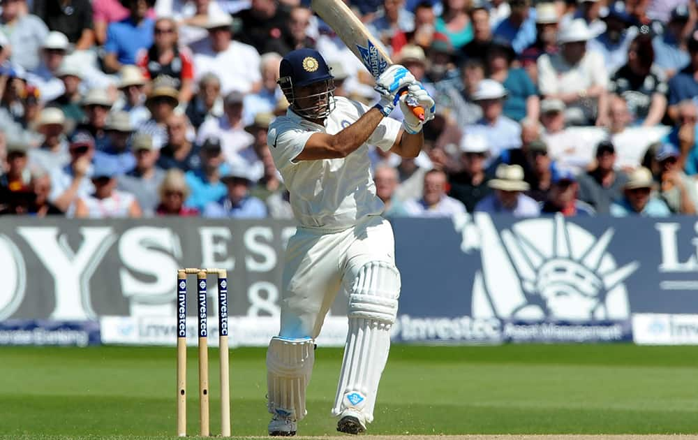 M.S. Dhoni plays a shot during day two of the first Test between England and India at Trent Bridge cricket ground, Nottingham, England.