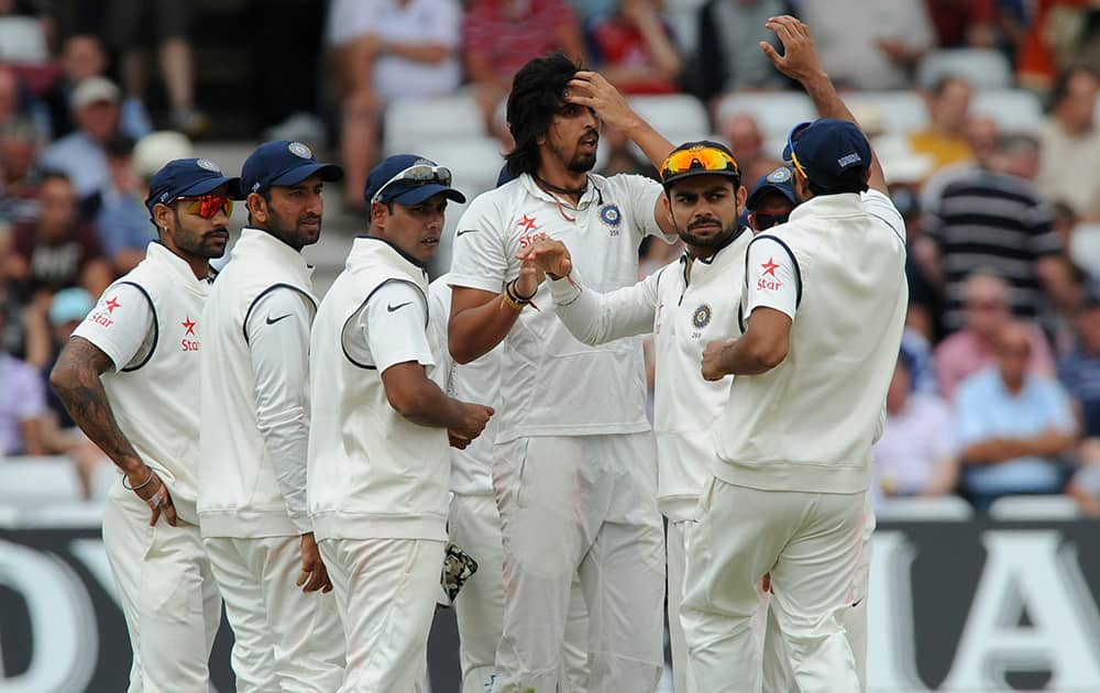 Ishant Sharma, center, celebrates with team mates after getting England's Sam Robson wicket LBW for 59 runs during day three of the first Test between England and India at Trent Bridge cricket ground, Nottingham, England.