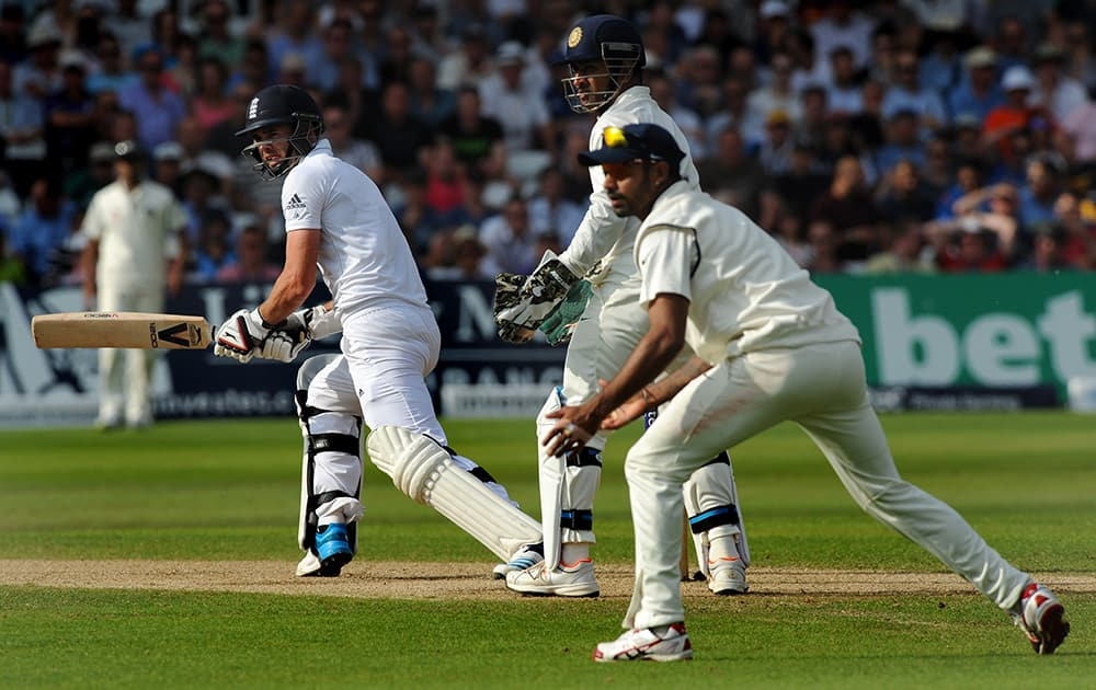 England's James Anderson, left, plays a reverse sweep shot during day three of the first Test between England and India at Trent Bridge cricket ground, Nottingham.