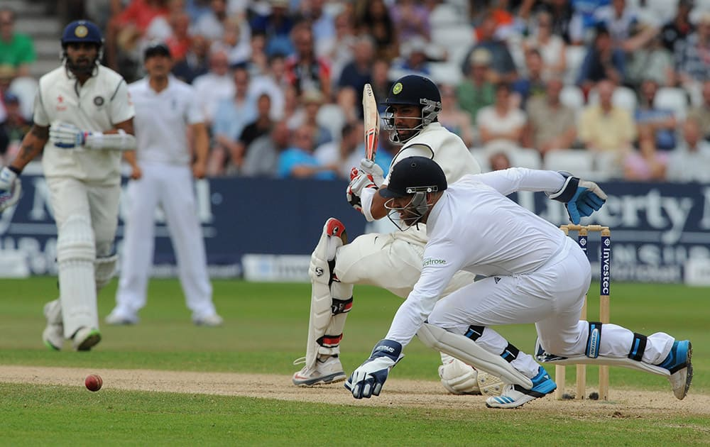 India's Cheteshwar Pujara plays a shot past England's wicket keeper Matt Prior during day four of the first Test between England and India at Trent Bridge cricket ground, Nottingham, England.