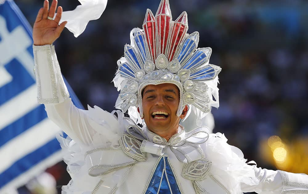 A performer waves during the closing ceremony for the World Cup before the final match between Germany and Argentina at Maracana Stadium in Rio de Janeiro, Brazil.