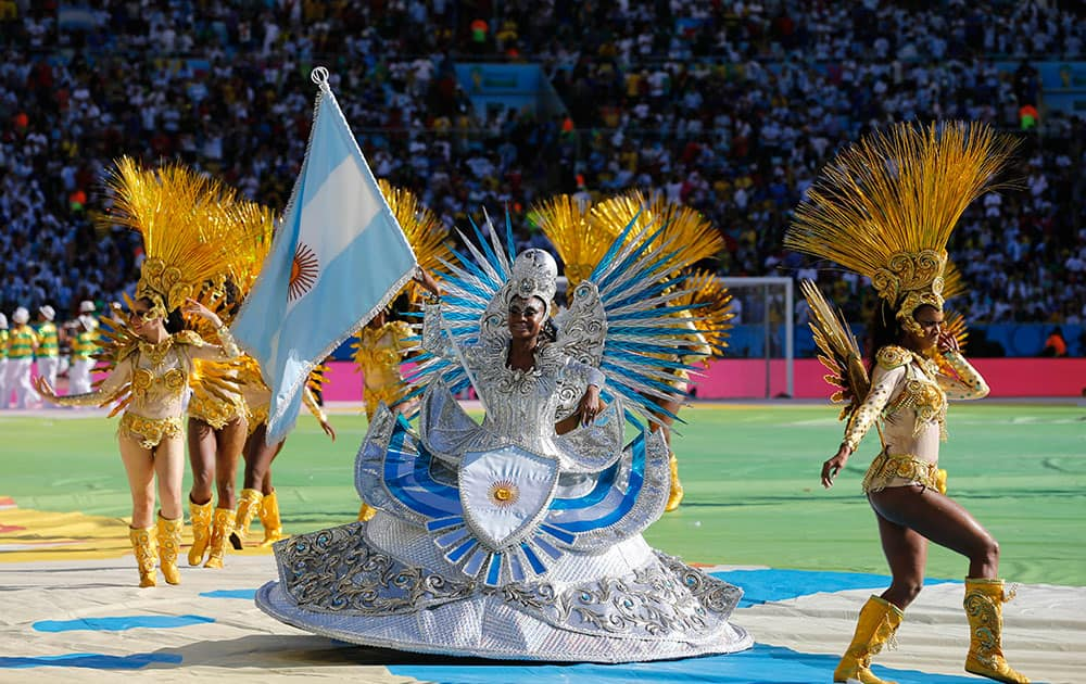 A performer carries the Argentine flag during the closing ceremony for the World Cup before the start of the final match between Germany and Argentina in Maracana Stadium in Rio de Janeiro