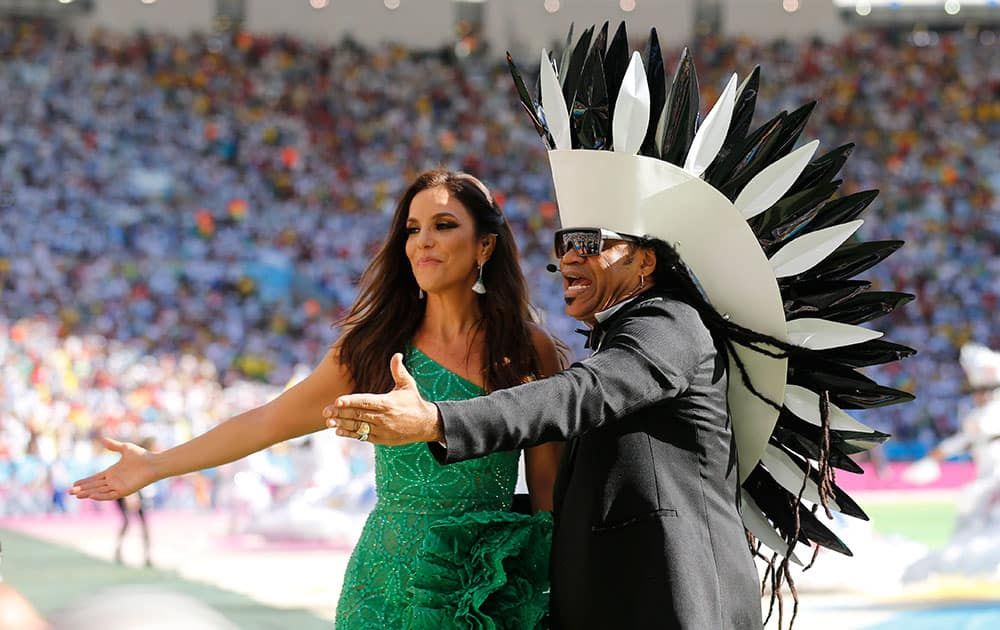 Brazilian singers Ivete Sangalo, left, and Carlinhos Brown perform during the closing ceremony for the World Cup before the final match between Germany and Argentina at Maracana Stadium in Rio de Janeiro, Brazil.