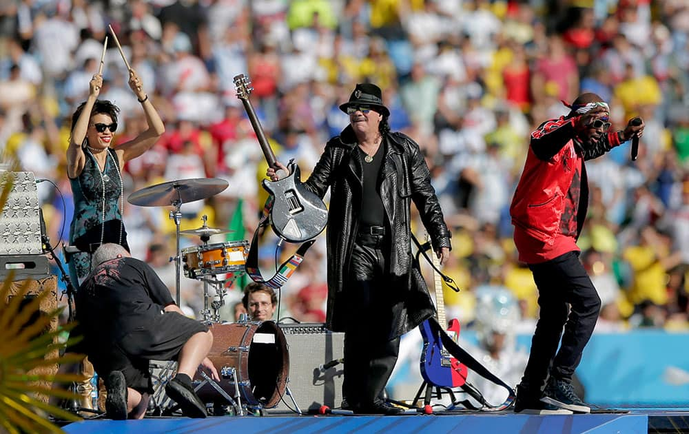 Musician Carlos Santana, centre, on stage during the closing ceremony before the World Cup final soccer match between Germany and Argentina at the Maracana Stadium in Rio de Janeiro, Brazil.