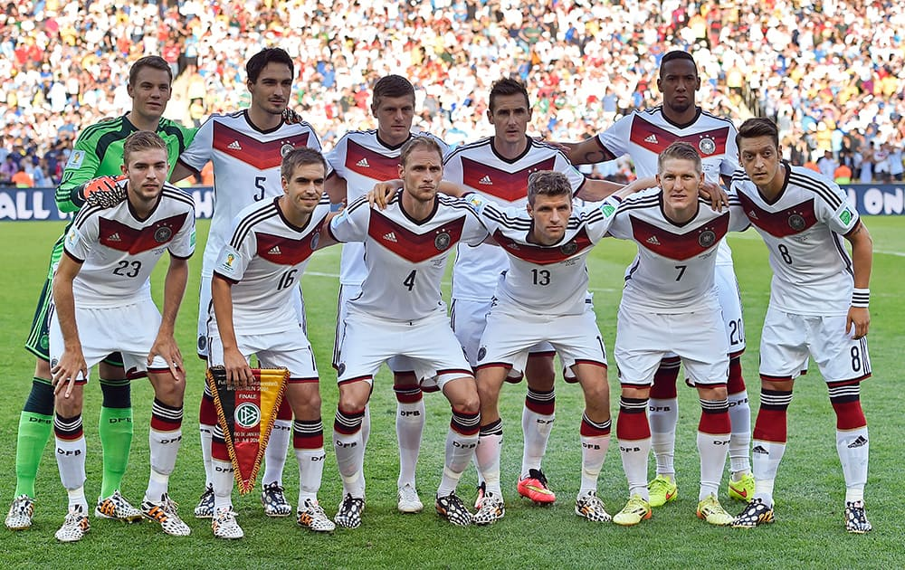 The German team poses for a group photo before the World Cup final soccer match between Germany and Argentina at the Maracana Stadium in Rio de Janeiro, Brazil.