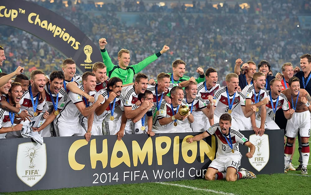 German players celebrate with the trophy after the World Cup final soccer match between Germany and Argentina at the Maracana Stadium in Rio de Janeiro.