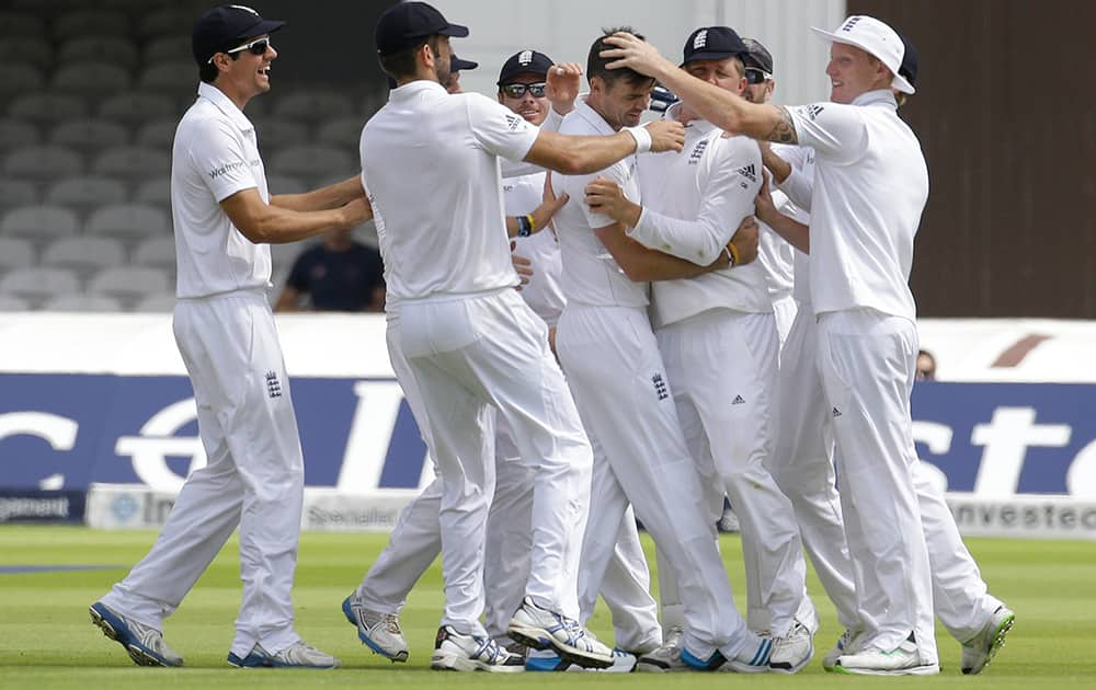 England's James Anderson celebrates the wicket of India's Shikhar Dhawan during the first day of the second test match between England and India at Lord's cricket ground in London.