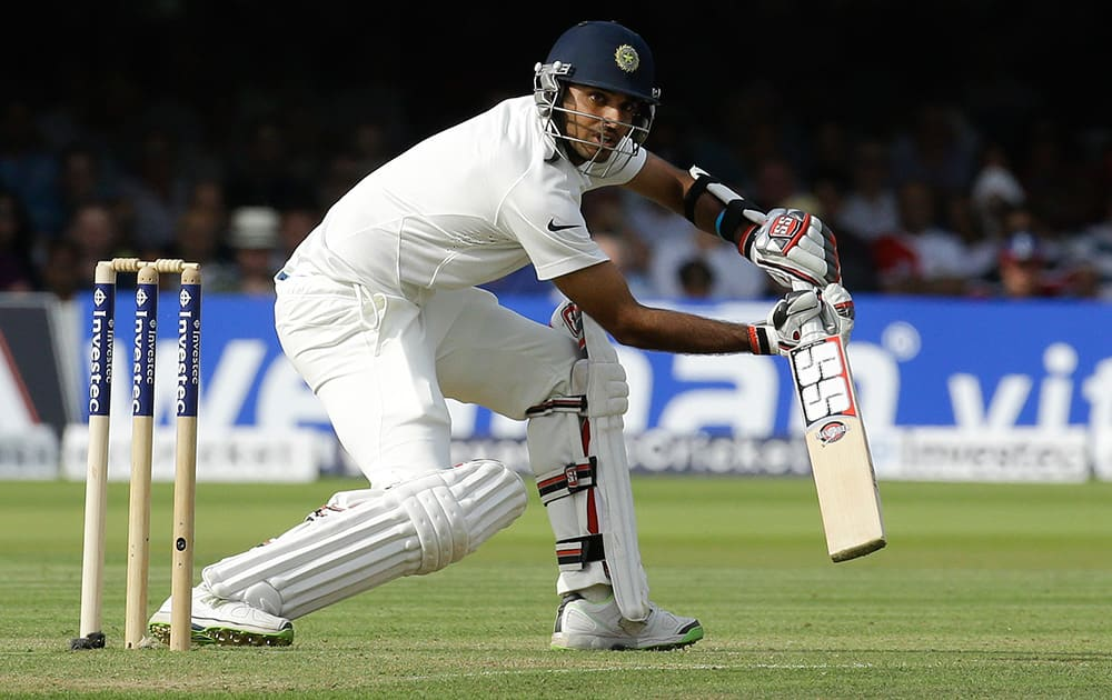 Bhuvneshwar Kumar plays a shot off the bowling of England's Ben Stokes during the first day of the second test match between England and India at Lord's cricket ground in London.