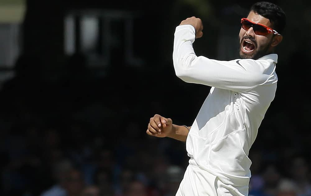 India's Ravindra Jadeja celebrates the wicket of England's Joe Root during the second day of the second test match between England and India at Lord's cricket ground in London.
