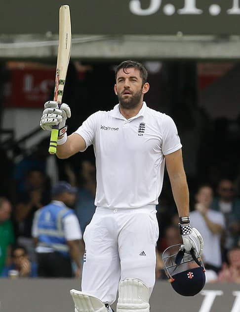 England's Liam Plunkett celebrates scoring a half century during the third day of the second test match between England and India at Lord's cricket ground in London.