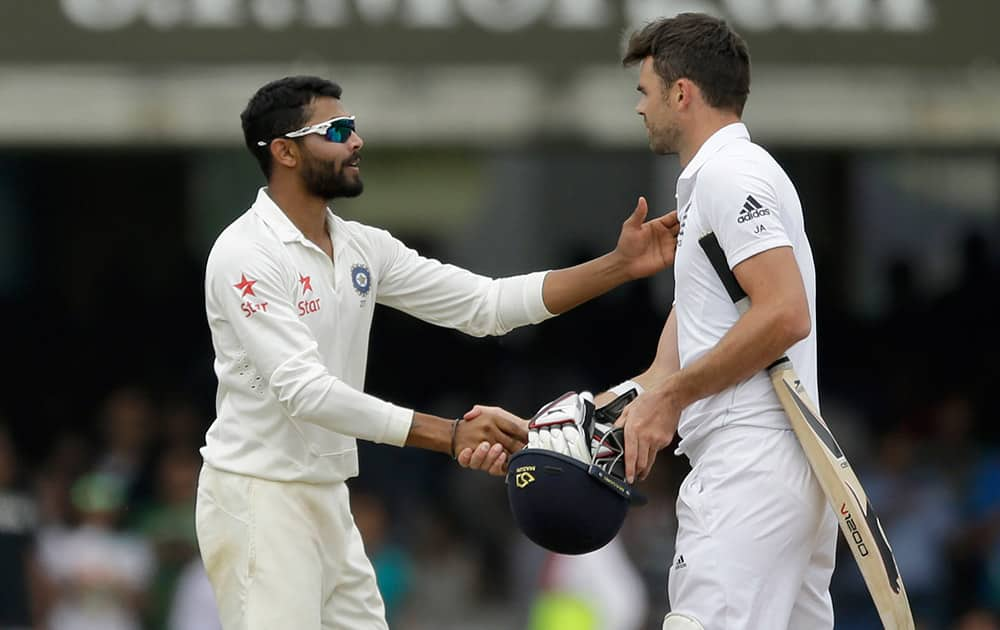 India's Ravindra Jadeja, left, shakes hands with England's James Anderson after running him out to win the test match on the fifth day of the second cricket test match between England and India at Lord's cricket ground in London.