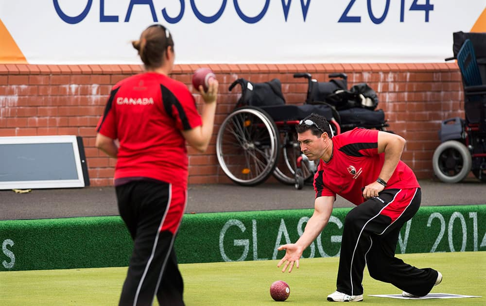 Lawn bowler Tim Mason practices at the Kelvingrove Lawn Bowls Centre at the Commonwealth Games in Glasgow, Scotland.