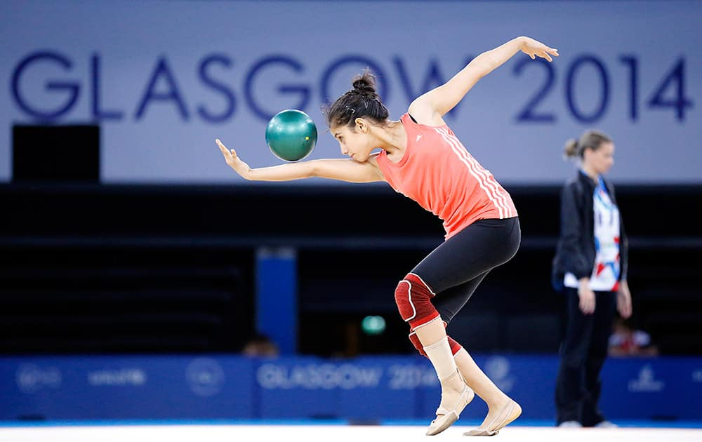 A rhythmic gymnastic athlete practices one day before the opening of the Commonwealth Games 2014 in Glasgow, Scotland.