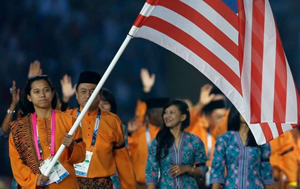Malaysia's flag bearer Muhammad Imaadi Aba Aziz during the opening ceremony for the Commonwealth Games 2014 in Glasgow, Scotland.