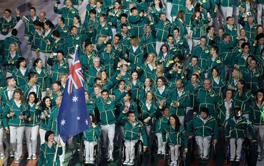 Australia's flag bearer Anna Meares leads the Australian team during the opening ceremony for the Commonwealth Games 2014 in Glasgow, Scotland.