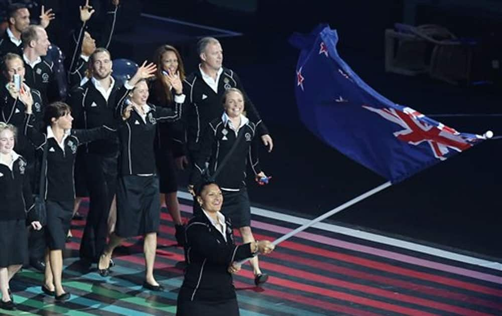 New Zealand's flag bearer Valerie Adams leads her team during the opening ceremony for the Commonwealth Games 2014 in Glasgow.