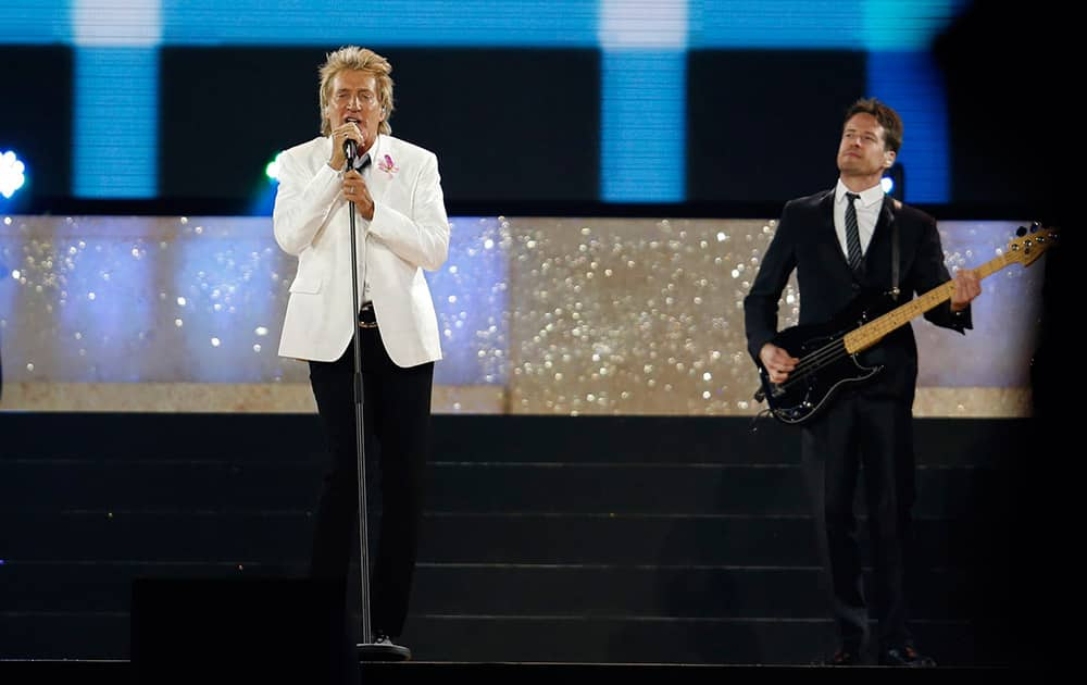 Singer Rod Stewart, left, performs during the opening ceremony for the Commonwealth Games 2014 in Glasgow, Scotland.