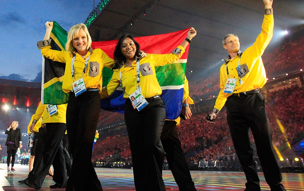 South African athletes react as they arrive in the stadium during the opening ceremony for the Commonwealth Games 2014 in Glasgow, Scotland.