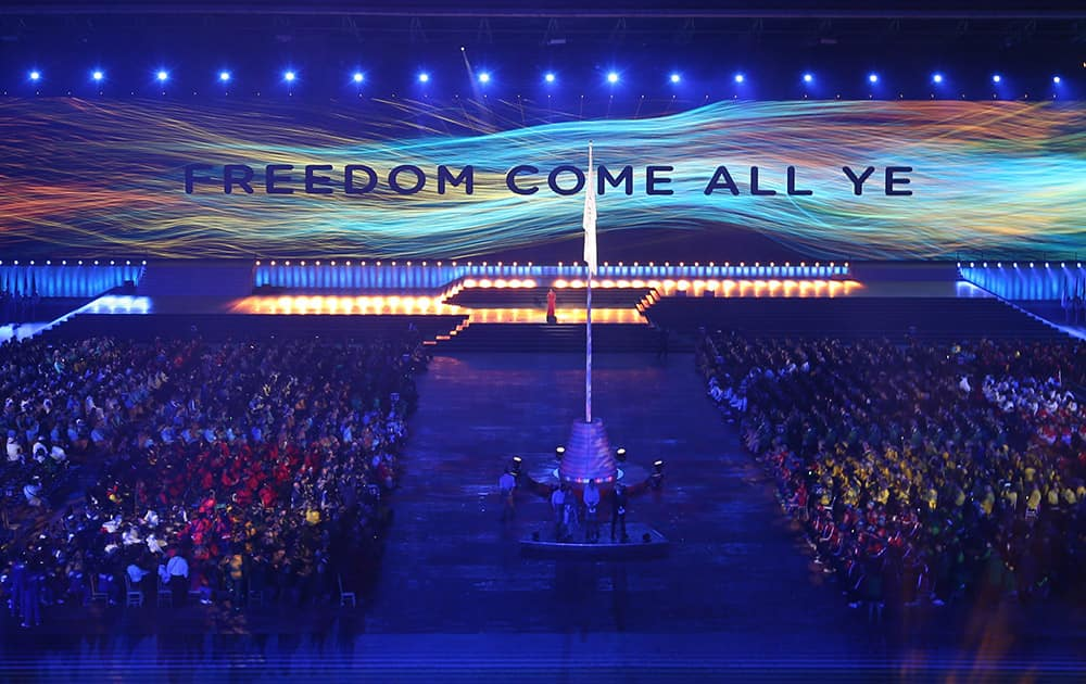 A message is displayed on a wall of video screen during the opening ceremony for the Commonwealth Games 2014 in Glasgow, Scotland.