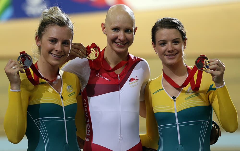England's Joanna Rowsell celebrates with her gold medal, Australia's Annette Edmonson with her silver and Australia's Amy Cure with her bronze medal after their women's 3000m Individual pursuit at the Velodrome in Glasgow, Scotland.