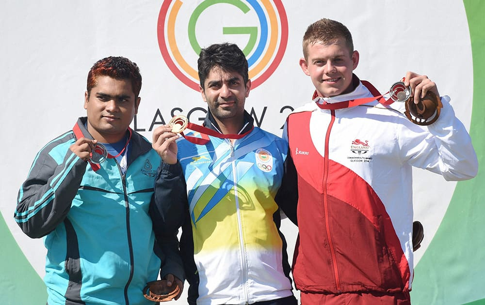 GOLD MEDALLIST INDIA`S ABHINAV BINDRA, SILVER MEDALLIST ABDULLAH BAKI OF BANGLADESH AND BRONZE MEDALLIST DANIEL RIVERS OF ENGLAND DURING THE MEDAL CEREMONY AFTER MEN`S 10M AIR RIFLE EVENT AT THE COMMONWEALTH GAMES IN GLASGOW, SCOTLAND.